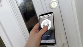 A staged picture of a smartphone and door