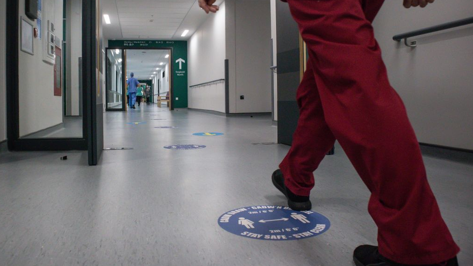 Nurse walking in a hospital corridor