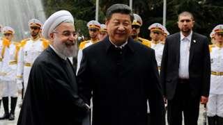 中国国家主席习近平和伊朗总统鲁哈尼。