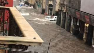 Flooding submerges streets in Catania