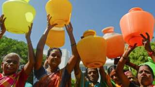 Indian women with empty plastic pots protest as they demand drinking water in Chennai on June 22, 2019.