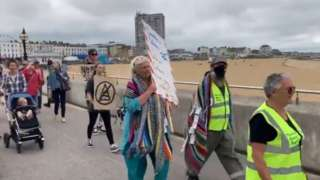 Protestors marching along Margate seafront