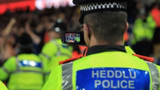 South Wales Police officer filming fans