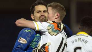 Partick goalkeeper Tomas Cerny and goalscorer Chris Erskine celebrate victory