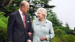 Prince Phillip, the Duke of Edinburgh, and Queen Elizabeth II arm in arm
