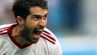 Karim Ansarifard celebrates a World Cup goal for Iran