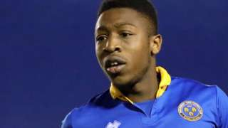 Ebou Adams in action for Shrewsbury