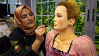 "Tuba Geckil adding the finishing touches to her life-size creation of Villanelle from BBC drama ""Killing Eve"", on display during Cake International 2019 at the NEC, Birmingham"