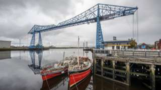 The Transporter Bridge and some fishing boats