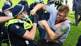 scuffle between protester and police