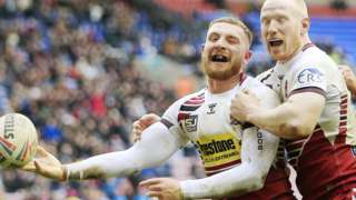Jackson Hastings celebrates a try for Wigan against Hull FC