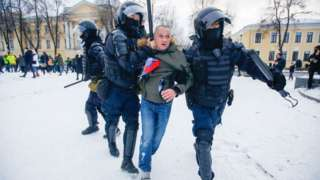 Police officers detain a protester in St. Petersburg