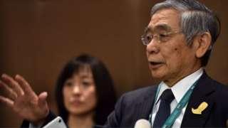 Governor of the Bank of Japan, Haruhiko Kuroda speaks to journalists.
