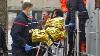 A Vietnamese pregnant migrant woman is evacuated