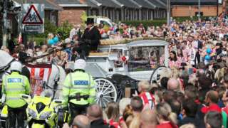 Bradley Lowery's funeral cortege with his coffin carried in a horse-drawn carriage
