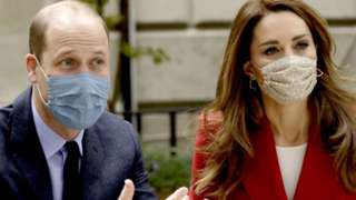 """The Duke and Duchess of Cambridge talk with medical staff during a visit to St. Bartholomew""""s Hospital in London, in October this year"""