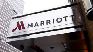 The Marriott hotel logo and name is seen on the steel awning of a Manhattan hotel