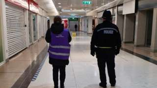 Two officers in a shopping centre