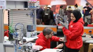University students prepare their entry for a national robotics competition