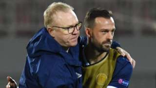 Scotland head coach Alex McLeish celebrates with Steven Fletcher