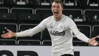 Derby County midfielder Krystian Bielik celebrates the opening goal against Bournemouth