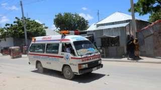 An ambulance is seen near a blast site that rocked a military base in Mogadishu