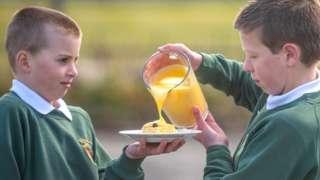 Schoolboys with dessert