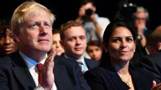 Boris Johnson and Priti Patel