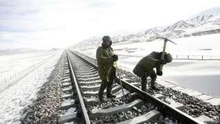 Men building railway