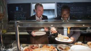 Tim Farron and Ade Adeyemo, local candidate for Solihull, make breakfast for visiting journalists at Cafe Shirley, a German cafe in Solihull.