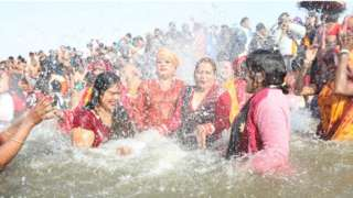 Women take a dip at the Kumbh Mela