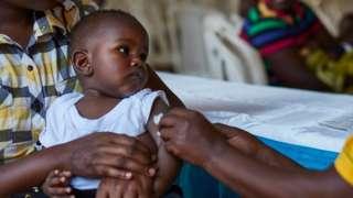 Child vaccinated against malaria
