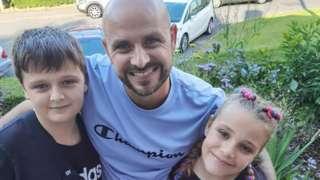 Jason Bennett with his children