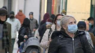 Woman wearing mask on Strand Street