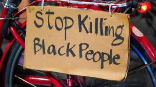 A sign on a bike readers 'Stop killing black people'