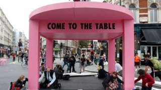 Extinction Rebellion protesters building a pink table