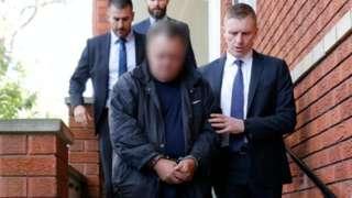 Police dey hold Scott Price for handcuffs