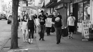 Participants in an August memorial march for victims of the overdose crisis walk through Vancouver streets
