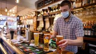 Barman serving pints