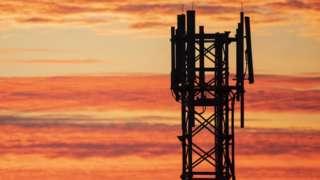 5G mast sunset