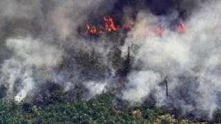 Aerial picture showing smoke from a two-kilometre-long stretch of fire billowing from the Amazon rainforest