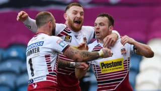 Liam Marshall's hat-trick at the John Smith's Stadium included two in Wigan's burst of three in six minutes just before the break