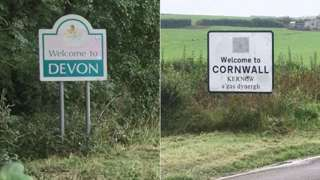 A sign from each county