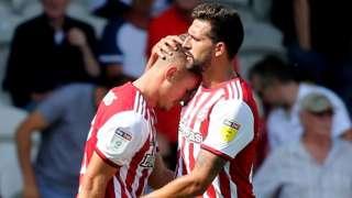 Brentford celebrate Sergi Canos' goal