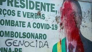 Billboard of President Jair Bolsonaro seen vandalised in Carpina, Pernambuco state, Brazil, on 27 March 2021