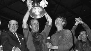 Manchester United captain Bobby Charlton holds the European Cup aloft