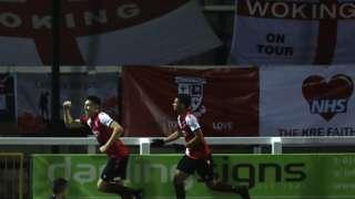 Woking celebrate a goal against Dagenham and Redbridge