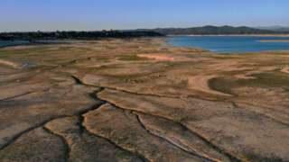 In an aerial view, low water levels are visible at Folsom Lake on May 10, 2021 in Granite Bay, California.