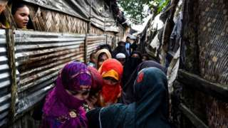 Rohingya family members gather as a part of religious ceremony in Kutupalong refugee camp in Ukhia near Cox's Bazar