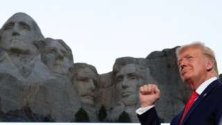 President Trump stands in front of Mount Rushmore